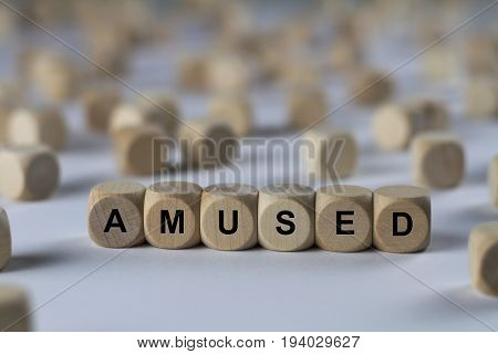 Amused - Cube With Letters, Sign With Wooden Cubes