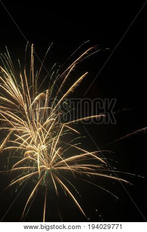 golden firework background with ample copy space for text