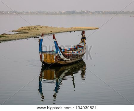 Wooden Boats On The Lake