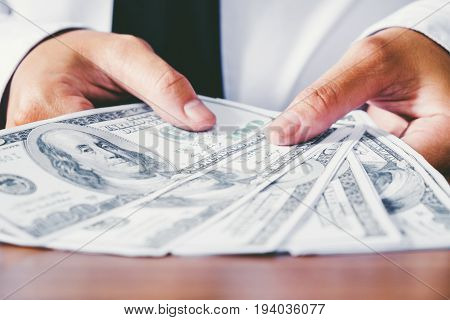 Money Dollar bills in Hand Businessman investment