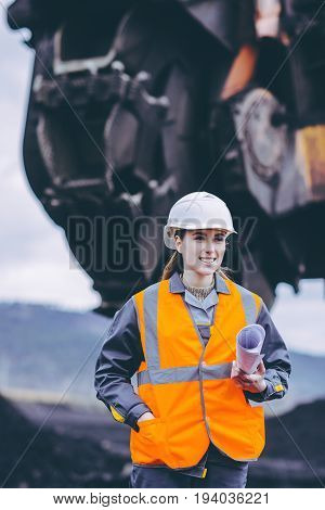 coal mining worker with excavator on the background