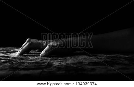 hand of woman climbing on wooden door In white tone (abuse concept )