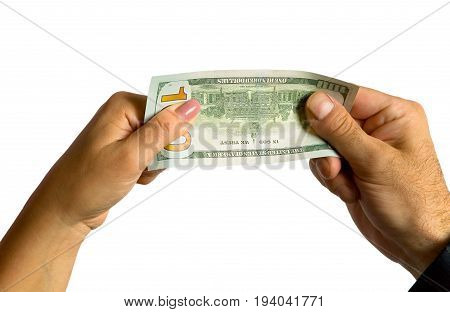 A man's hand and a woman's hand hold a hundred-dollar bill. On a white background.