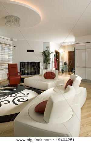 Close up details of stylish modern living room with cream settee.