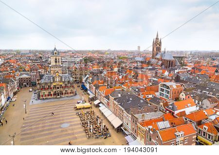 Delft, Netherlands - April 6, 2016: Aerial panoramic downtown street view with square and houses in Delft, Holland