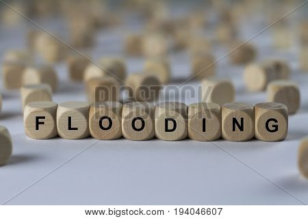 Flooding - Cube With Letters, Sign With Wooden Cubes