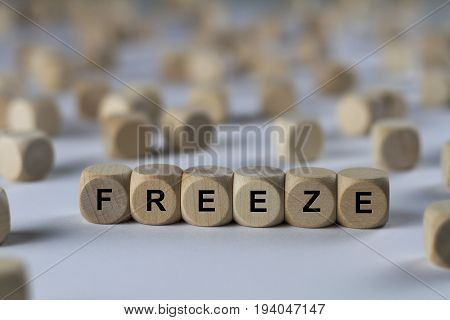 Freeze - Cube With Letters, Sign With Wooden Cubes