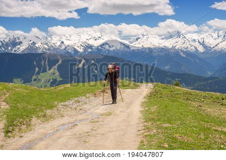 Traveler With Big Backpack In The Mountains