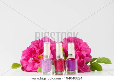 Color nail polish in bottle on white