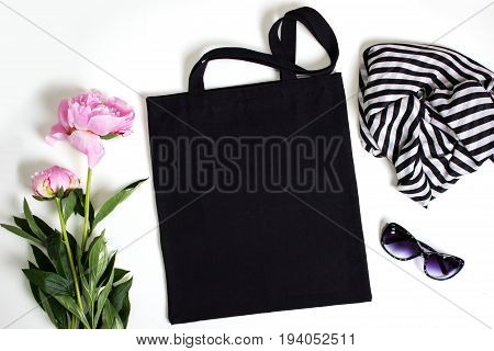 Black blank cotton eco tote bag with pink peony glasses and scarf design mockup.