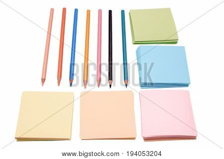 Many Colored Crowns And Colored Paper For Writing, Isolated On White Background
