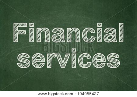 Banking concept: text Financial Services on Green chalkboard background