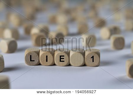 Lie 1 - Cube With Letters, Sign With Wooden Cubes