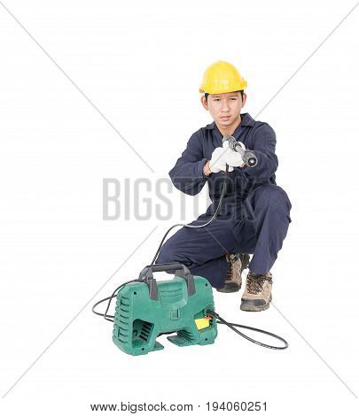 Young Man Sitting And Holding High Pressure Water Gun