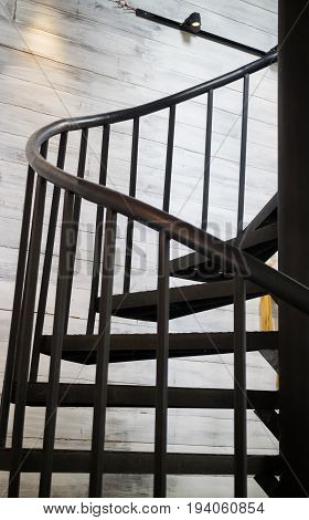 Dark iron metal spiral staircase stock photo