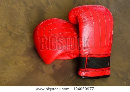 Sport Equipment On Dark Beige Background. Pair Of Boxing Sportswear