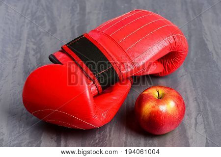 Professional Box Fight And Dieting Concept. Boxing Gloves In Red