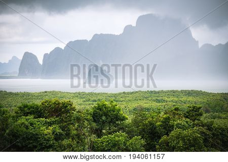 Cloudy sky and fog after raining cover island near green beach called 'Samet Nangshe' which is attractive place in Phang Nga of Thailand.