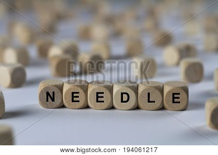 Needle - Cube With Letters, Sign With Wooden Cubes