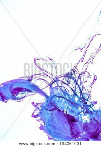 Ink swirl in a water on white background. The paint in the water. Soft dissemination a droplets of colored ink in water close-up. Explosion of color splashes acrylic ink.