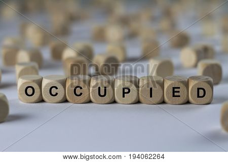 Occupied - Cube With Letters, Sign With Wooden Cubes