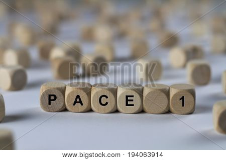 Pace 1 - Cube With Letters, Sign With Wooden Cubes