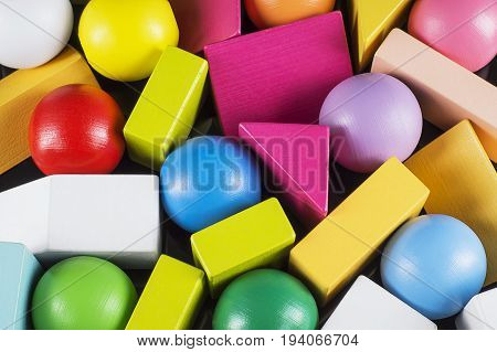 Abstract Background. Background with different colorful shapes wooden blocks. Geometric shapes in different colors. Concept of creative logical thinking.