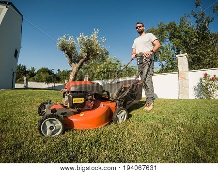Bearded Man With A Lawnmower