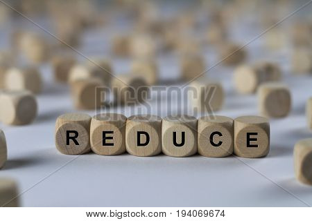 Reduce - Cube With Letters, Sign With Wooden Cubes