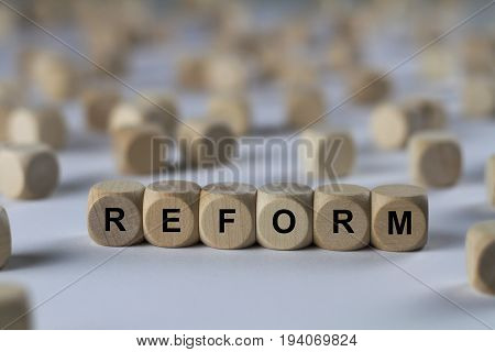 Reform - Cube With Letters, Sign With Wooden Cubes