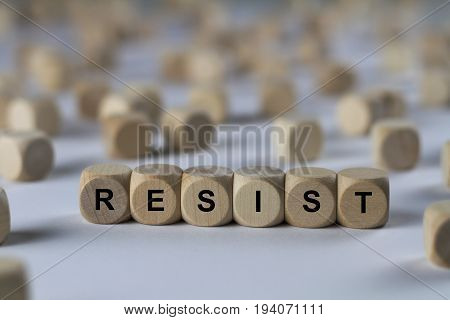 Resist - Cube With Letters, Sign With Wooden Cubes