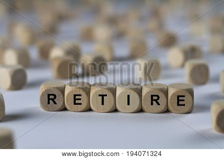 Retire - Cube With Letters, Sign With Wooden Cubes
