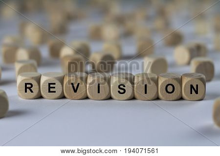 revision - cube with letters sign with wooden cubes poster