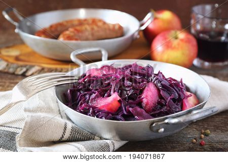 Stewed red cabbage with spices and apples. Garnish for fried sausages