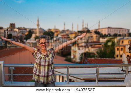 Young Blue Girl Standing On The Terrace, Open Arms, Openness, Sunset, Warm Day, Smile On Face