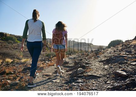 Two Young Ladies Strolling Up Hill