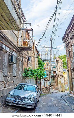 The Car Among Abandoned Houses