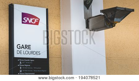 Close-up On The Sign Of The Sncf Station Of Lourdes, France