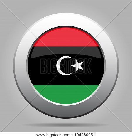 National flag of Libya. Shiny metal gray round button with shadow.