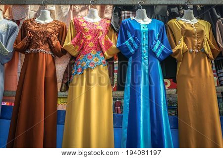 Variety and colourful of Malaysian traditional baju kurung display in shop for sale.A baju kurung is a loose fitting full length dress, consisting of a skirt and a blouse.