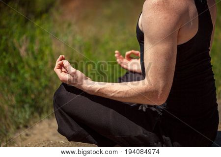Fit Young Man Practices Sun Salutation Yoga On The Beach. Young Man Enjoying Meditation And Yoga. Fi
