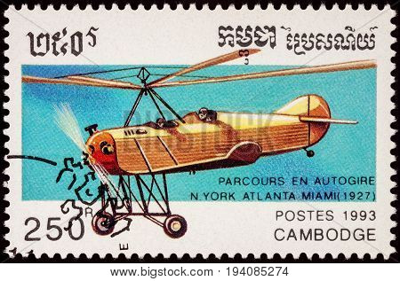 Moscow Russia - July 06 2017: A stamp printed in Cambodia shows autogyro dedicated flight from New York Atlanta Miami in 1927 series