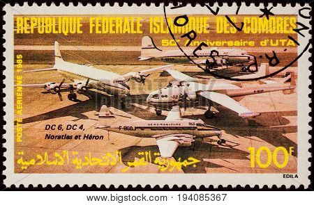 MOSCOW RUSSIA - July 06 2017: A stamp printed in Comoros shows aircrafts DC-4 DC-6 Nord Noratlas De Havilland Heron series