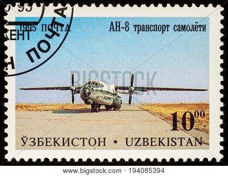 Moscow Russia - July 05 2017: A stamp printed in Uzbekistan shows transport plane Antonov AN-8 series