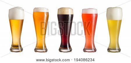 Five glasses of different types of cold craft beer isolated on white background