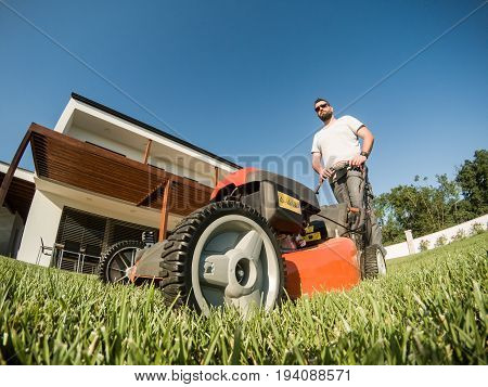 Adult Bearded Male With Lawnmower