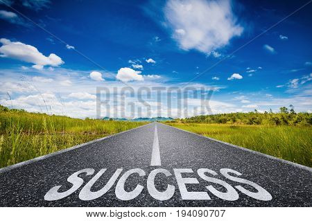 road to success concept with 3d rendered success text on asphalt road