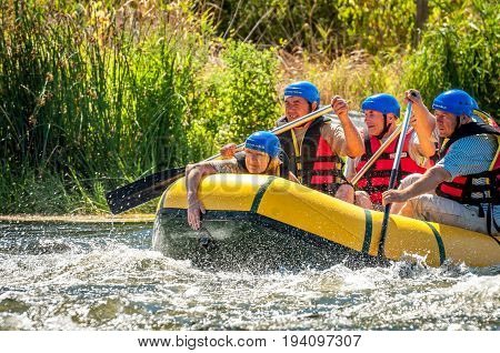 Village Myhiya Nikolaev region Ukraine - July 2 2017: Elderly men and women are engaged in rafting. A popular place for extreme recreation and training of rafting and kayaking athletes.