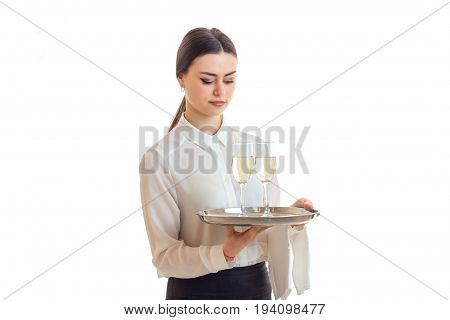 pretty young waitress with trey in hands in uniform isolated on white background