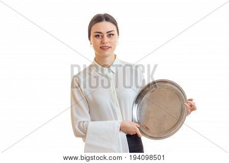 charming young waitress with trey in hands in uniform isolated on white background